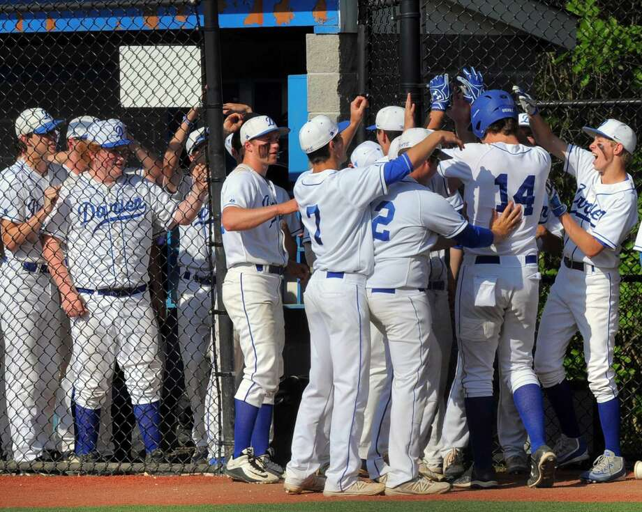 Darien celebrates Casey Brown's fourth inning homerun against Danbury in an FCIAC baseball playoff game at Darien High School on Friday, May 20, 2016.