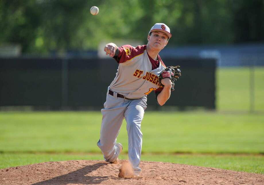 Connor Hurley (16) of the St. Joseph Cadets delivers a pitch during a game against the Trumbull Eagles at Trumbull High School on May 20, 2016 in Trumbull, Connecticut.