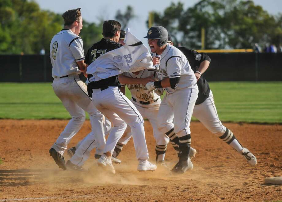 Members of the Trumbull High School baseball team celebrate Kris DiCocco's walk off victory against the St. Joseph Cadets at Trumbull High School on May 20, 2016 in Trumbull, Connecticut.