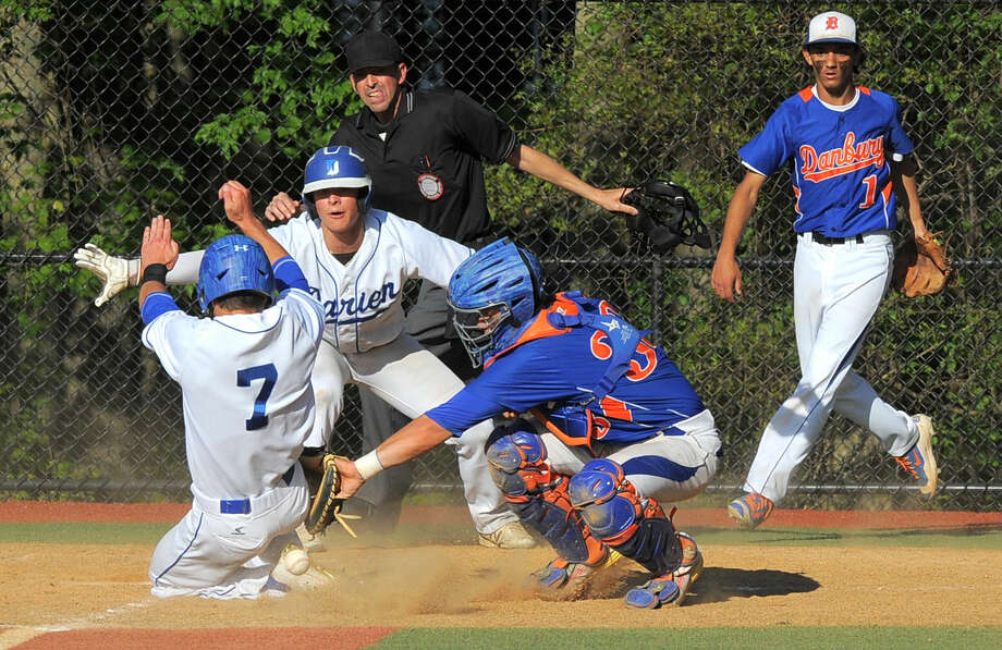 Darien Richard Brereton slides past the throw to Danbury catcher Mike Halas to score in the bottom of the fifth inning, along with James Schofield in an FCIAC baseball playoff game at Darien High School on Friday, May 20, 2016.