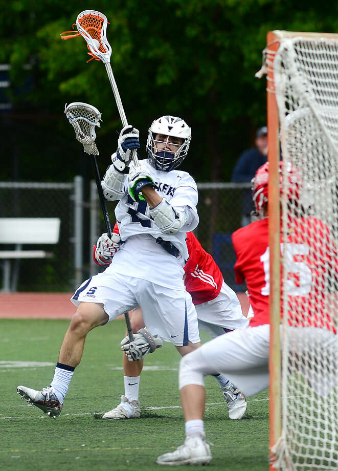 Connor Chamberlin of the Staples High School Boys Lacrosse team takes a shot on the Greenwich goal in their FCIAC boys lacrosse playoff game in Westport, Conn. Saturday, May 21, 2016.