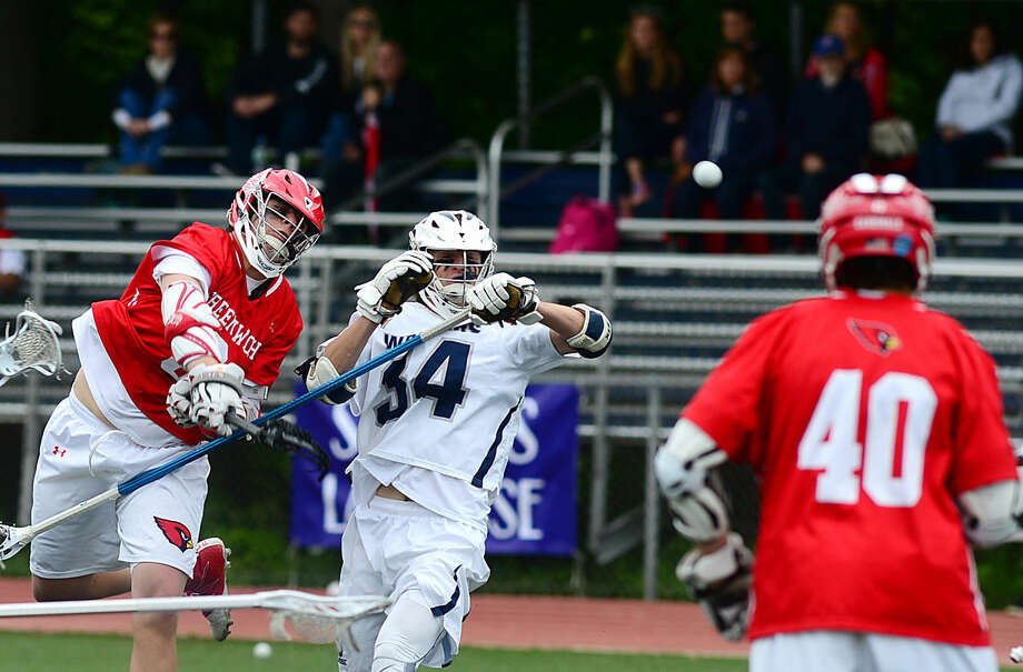 Michael Sands of the Greenwich High School Boys Lacrosse team takes a shot past Staples' Samuel Ahlgrin in their FCIAC boys lacrosse playoff game in Westport, Conn. Saturday, May 21, 2016.