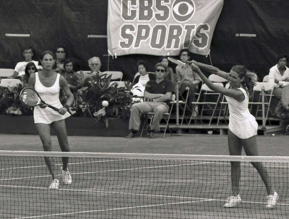 FILE - In this September, 1977 file photo, Renee Richards, left, watches as Betty Ann Stuart hits during the U.S. Open women's doubles championship tennis match against Betty Stove and Martina Navratilova at Forest Hills, N.Y. Richards, who was denied the opportunity to play as a woman in the 1976 U.S. Open, was born Richard Raskind, a former captain of the Yale tennis team who had sex reassignment surgery. (AP Photo, File)