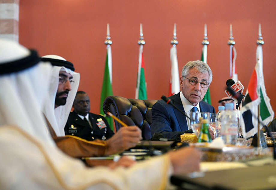 """U.S. Defense Secretary Chuck Hagel, addresses his Gulf counterparts during a meeting in the Conference Palace, Jeddah, Saudi Arabia, Wednesday, May 14, 2014. In remarks opening a conference, Hagel said Wednesday that Washington is hopeful of progress this week in the Iran deal-drafting talks in Vienna. Hagel said that regardless of the outcome of the Iran negotiations, the U.S. will remain """"postured and prepared"""" to ensure that Iran does not acquire a nuclear weapon. (AP Photo/Mandel Ngan, Pool)"""