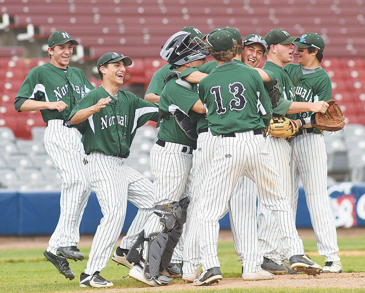 Hour photo/John Nash - Norwalk celebrates its 2-1 victory over Norwich Free Academy in a Class LL quarterfinal at Dodd Stadium in Norwich.