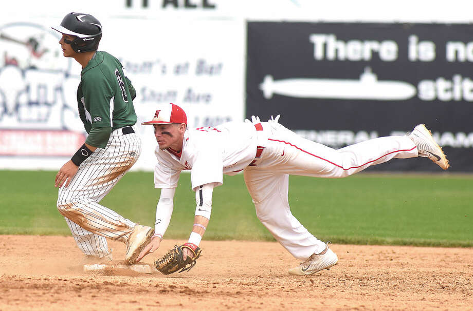 Hour photo/John Nash - Norwalk's Reid Singewald, left, is safe at second on a fielder's choice as Norwich Free Academy's Brandon Russo gets up ended on the play.
