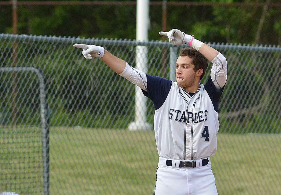 Staples' Nate Panzer points over to the Wreckers' bench after he hit a triple in the their 8-5 win over Greenwich. (Hour Photo/Alex von Kleydorff)