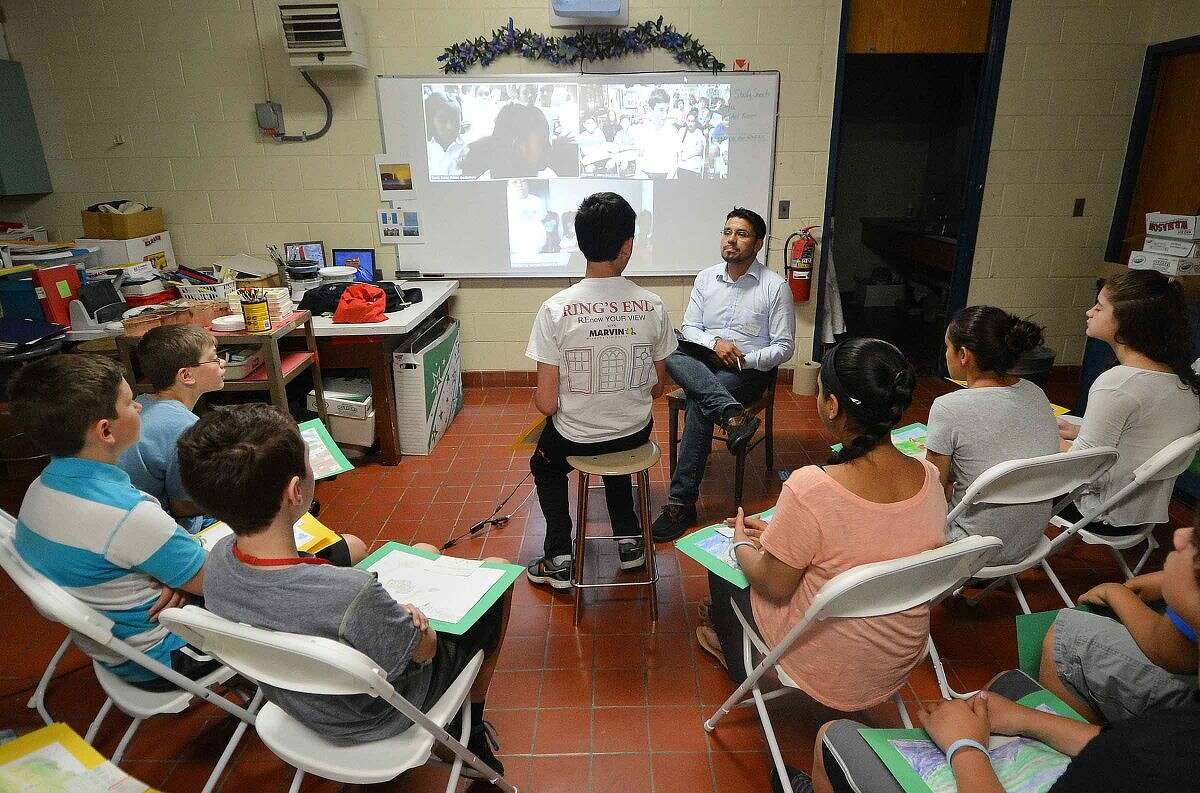 Hour Photo/Alex von Kleydorff Creative Connections Operations Director Miguel Barreto moderates a video conference call from Nathan hale Middle School and two schools in Gutamala. 6th grader Will french speaks to the kids about their favorite foods, and sports during the call