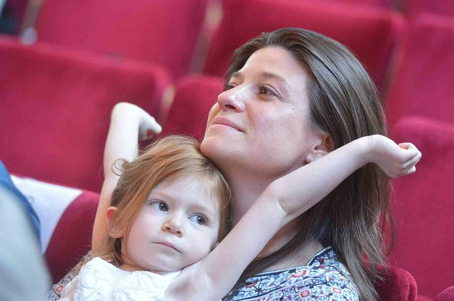 Earl Carpenters granddaughter Katy Schermann holds on to his great granddaughter Sadey at the the Veterans Hall of Honor Dedication Ceremony at Norwalk City Hall in Norwalk Conn. May 22 2016