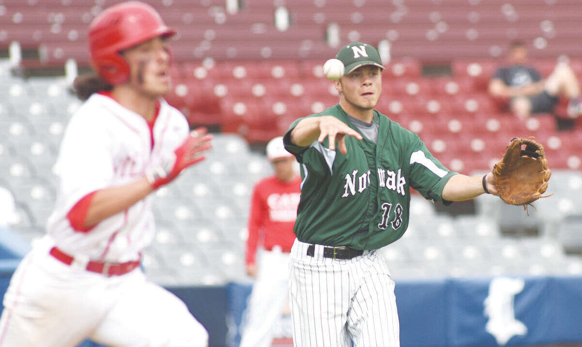 Hour photo/John Nash - Norwalk starting pitcher Dave Balunek, right, fires to first to beat NFA's Griffen Gooden on a comebacker to the mound.