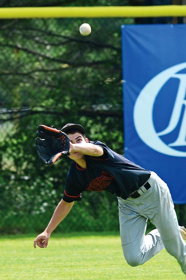 Hour photo / Erik Trautmann The Stamford High School baseball team battles Southington in their CIAC semi-final game in Southington Friday.