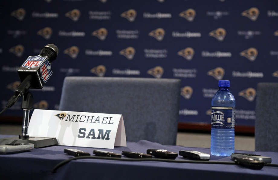 Audio recorders sit on a table as reporters wait for the start of a news conference with St. Louis Rams seventh-round draft pick Michael Sam at the NFL football team's practice facility Tuesday, May 13, 2014, in St. Louis. (AP Photo/Jeff Roberson)