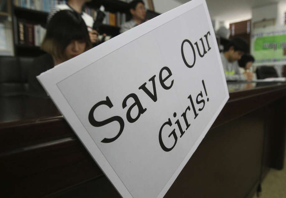 Christians pray during a service to support the release of kidnapped girls in Nigeria, at a church in Seoul, South Korea, Wednesday, May 14, 2014. Boko Haram, the militant group that kidnapped nearly 300 schoolgirls in Nigeria, said the girls will only be freed after the government releases jailed militants. (AP Photo/Ahn Young-joon)