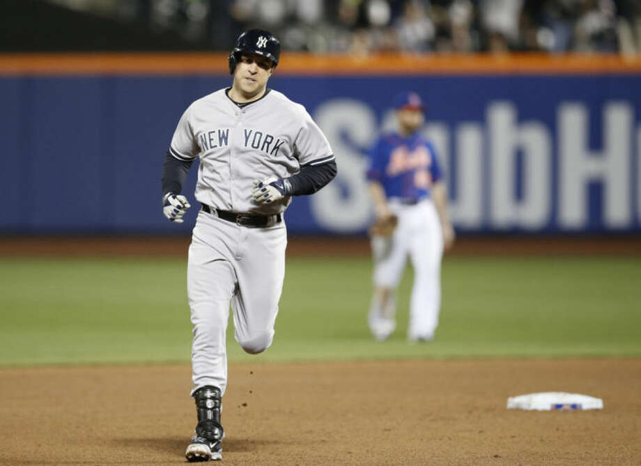 New York Yankees Mark Teixeira trots the bases after hitting a sixth-inning solo homer run off New York Mets starting pitcher Rafael Montero in a baseball game in New York, Wednesday, May 14, 2014. (AP Photo)
