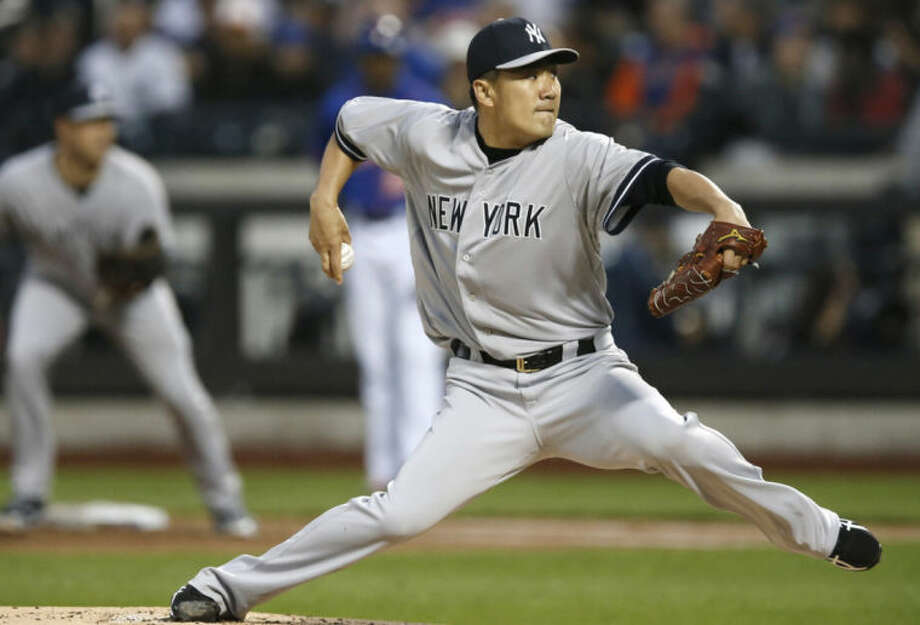 New York Yankees starting pitcher Masahiro Tanaka delivers in the first inning against the New York Mets in a baseball game in New York, Wednesday, May 14, 2014. (AP Photo)