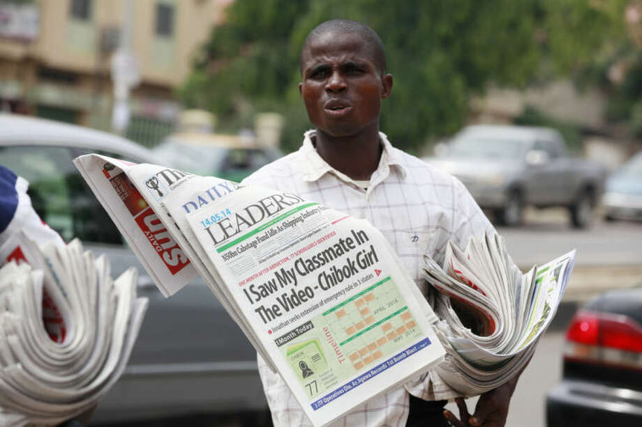 "Vendors sell local newspapers with headlines stating ""I saw my classmate in the Video"" referring to the kidnapped school girls of a government secondary school Chibok, in a video released on Monday by Boko haram in Abuja, Nigeria, Wednesday, May 14, 2014. A Nigerian government official said ""all options are open"" in efforts to rescue almost 300 abducted schoolgirls from their captors as US reconnaissance aircraft started flying over this West African country in a search effort. Boko Haram, the militant group that kidnapped the girls last month from a school in Borno state, had released a video yesterday purporting to show some of the girls. A civic leader said representatives of the missing girls' families were set to view the video as a group later today to see if some of the girls can be identified. (AP Photo/Sunday Alamba)"