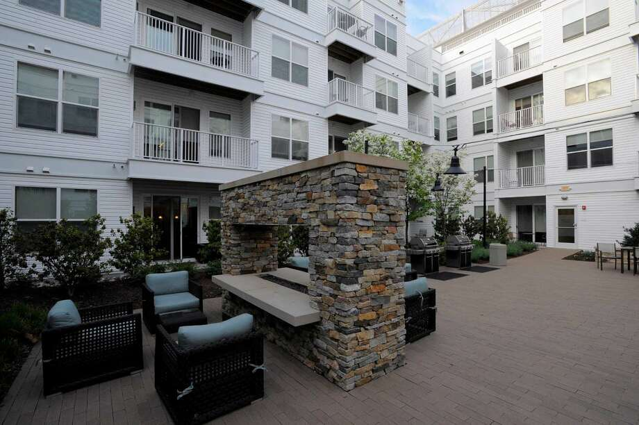 An exterior shot of one of four outside patio areas that includes a fire pit and grills for residents of 75 Tresser in Stamford on May 11, 2016.