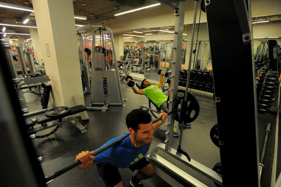 Brian Petroccio works out in the gym for residents of 75 Tresser in Stamford on May 11, 2016.