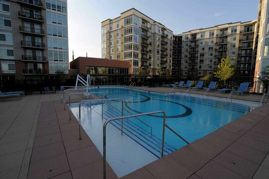 Residents of the Postmark Apartments can enjoy a pool within a communal courtyard area.