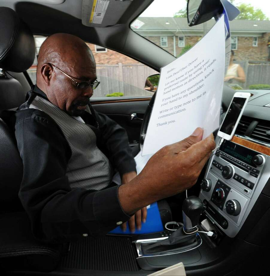 Paul Dimiti of Stamford, who is hearing impaired and recently started driving for Uber, gets ready to head out from his Stamford home on May 17, 2016 to pick up a client.