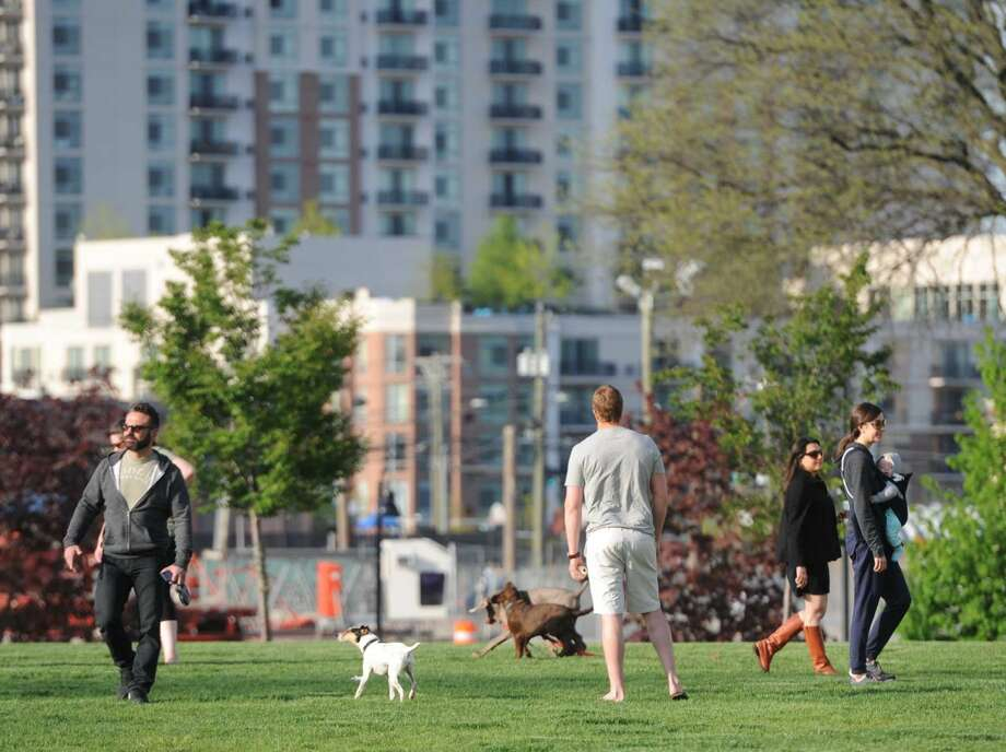Harbor Point area residents enjoy a warm spring evening at the park on May 12, 2016.