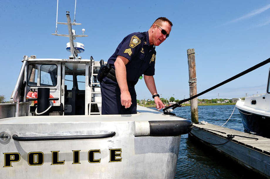 Hour photo / Erik Trautmann Seargant Peter Lapak has served in the Norwalk Police Department Marine Unit for the past 25 years.