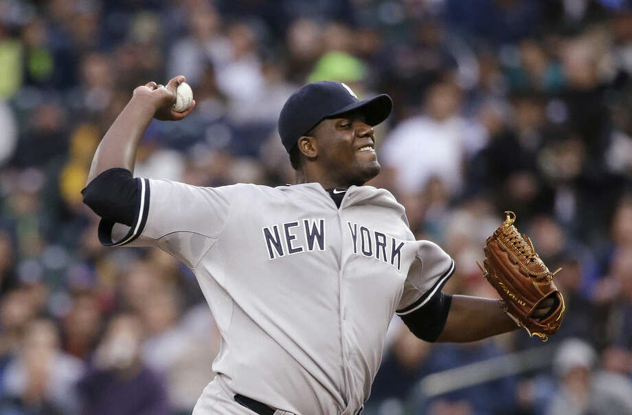 New York Yankees starting pitcher Michael Pineda throws against the Seattle Mariners in the first inning of a baseball game Monday, June 1, 2015, in Seattle. (AP Photo/Elaine Thompson)