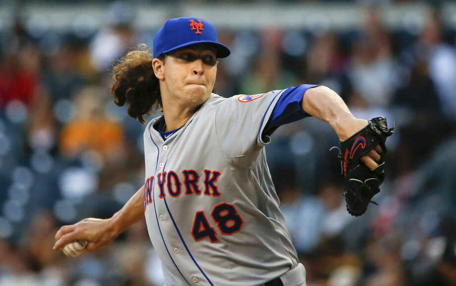 New York Mets starting pitcher Jacob deGrom throws against thew San Diego Padres in the first inning of a baseball game Monday, June 1, 2015, in San Diego. (AP Photo/Lenny Ignelzi)