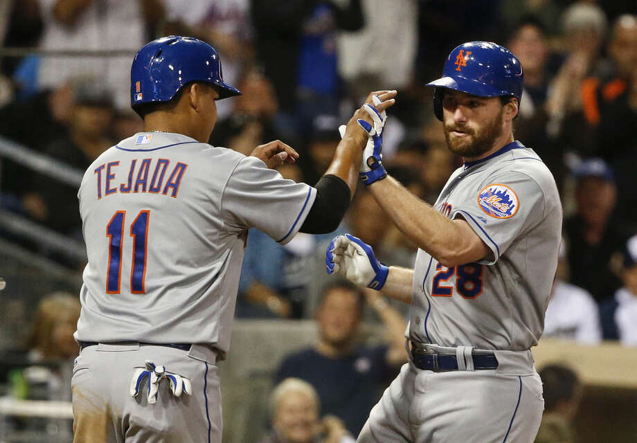 New York Mets' Daniel Murphy is met by Ruben Tejada after his two-run homer against the San Diego Padres in the fifth inning of a baseball game Monday, June 1, 2015, in San Diego. (AP Photo/Lenny Ignelzi)