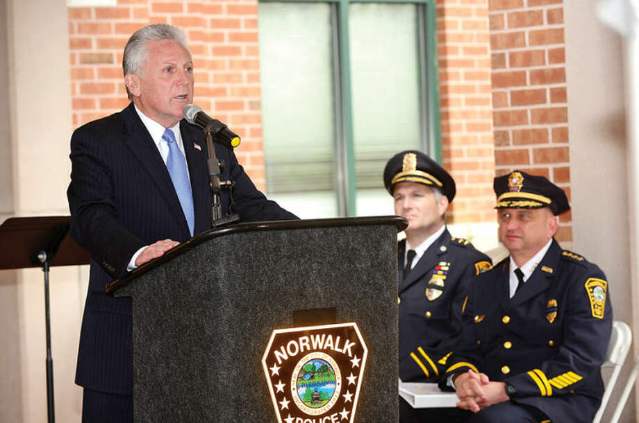 Hour photo / Erik Trautmann Mayor Harry Rilling and the Norwalk Police Department honor the four Norwalk officers who have given their lives in the line of duty as well as those retired officers the department has lost in the past year in a memorial ceremony Wednesday morning.