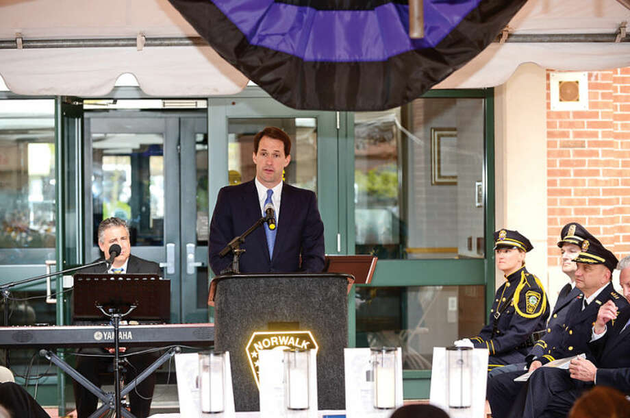 Hour photo / Erik Trautmann Congressman Jim Himes and Norwalk Police Department honor the four Norwalk officers who have given their lives in the line of duty as well as those retired officers the department has lost in the past year in a memorial ceremony Wednesday morning.