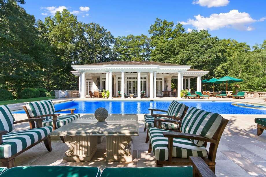 20 Andrews Farm Rd, Greenwich, CT 06831 -6 beds 10.5 baths 9,744 sqft.Features: Pool house and cabana, old-fashioned ice cream parlor, a golf-simulator room, a movie theater and a wine cellar