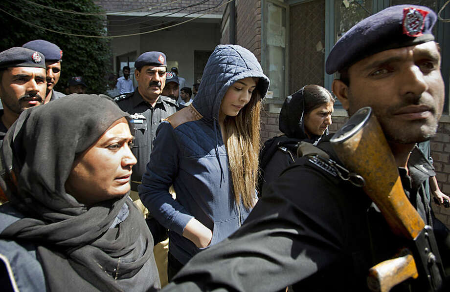 Pakistan's top model, Ayaan Ali, center, arrives in tight security to appear in a court in Rawalpindi, Pakistan, Monday, June 1, 2015. Ali is under detention since her midnight arrest on March 14 at Islamabad airport and faces money laundering charges after authorities seized over $500,000 before she boarded a Dubai-bound flight. Pakistani law makes it illegalfor a passengercarry over $10,000 ona flight. (AP Photo/B.K. Bangash)