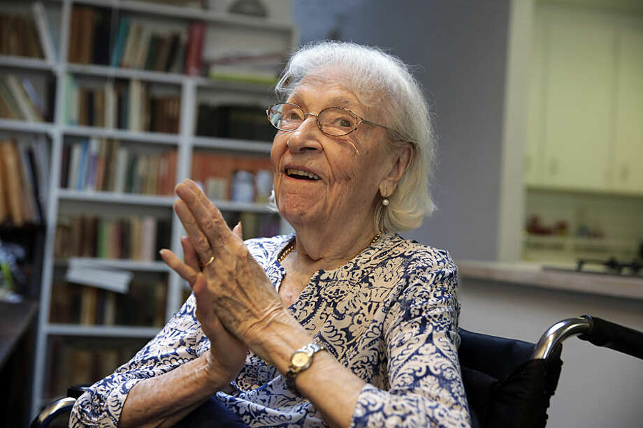 In this Friday, May 29, 2015 photo, artist Carmen Herrera is interviewed in her New York studio. Herrera, who turned 100 on Sunday, May 31, says she's still bursting with ideas she wants to put on canvas. (AP Photo/Richard Drew)
