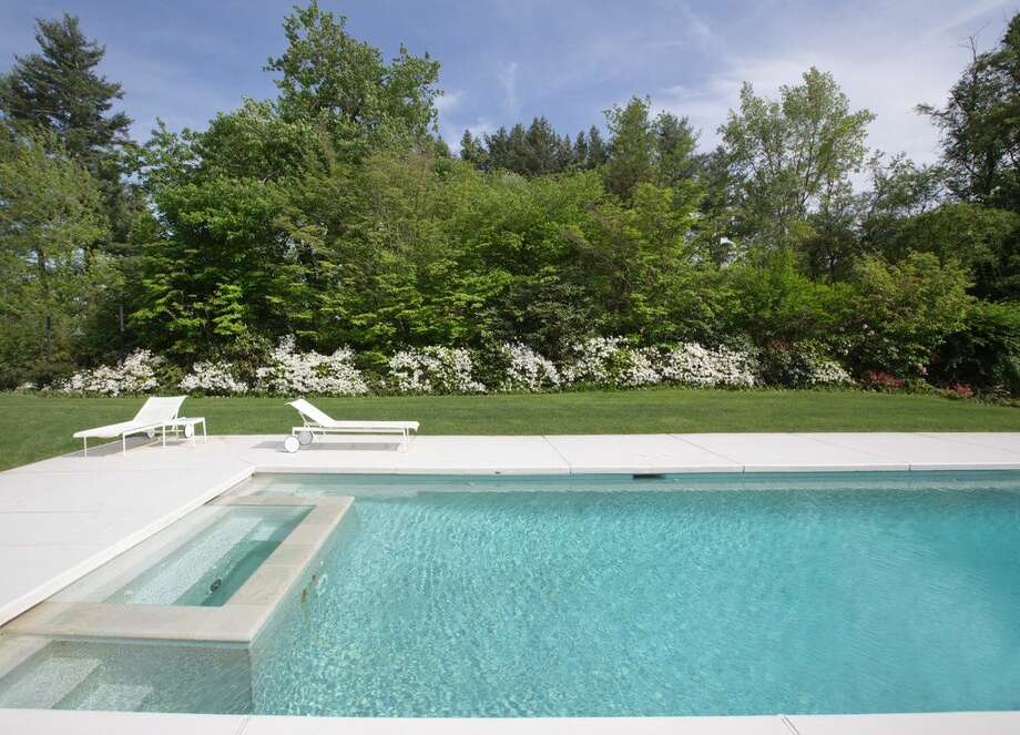 23 Spring Lake Rd, Sherman, CT 06784 - 4 beds 5 baths 5,936 sqft.Features: Sleek pool and hot tub, stone patio and dome for the winter months, tennis court