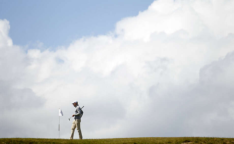 Germany's Maximilian Kieffer lines up a putt on the eighth hole during the final round of the Irish Open Golf Championship at Royal County Down, Newcastle, Northern Ireland, Sunday, May 31, 2015. (AP Photo/Peter Morrison)