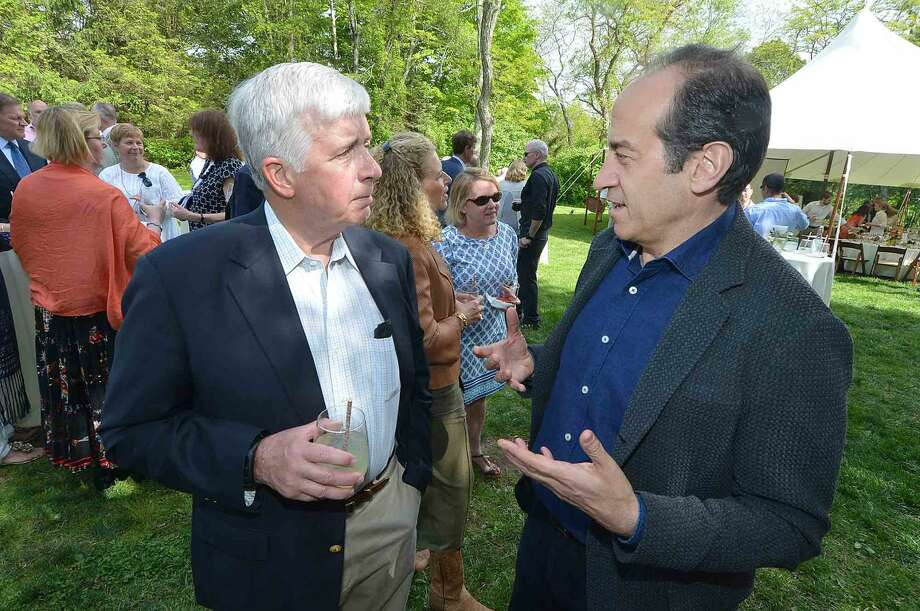 Hal Higby talks with Jesse Fink at the Wilton Family Y Community Celebration and dinner at Millstone Farm in Wilton Conn, Mayy 22 2016