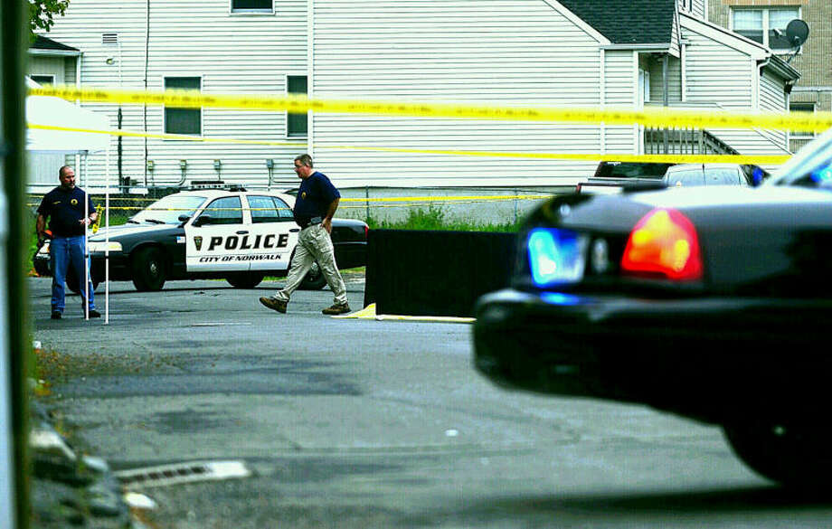 Norwalk police at the scene of a shooting in Norwalk on Thursday, May 15.
