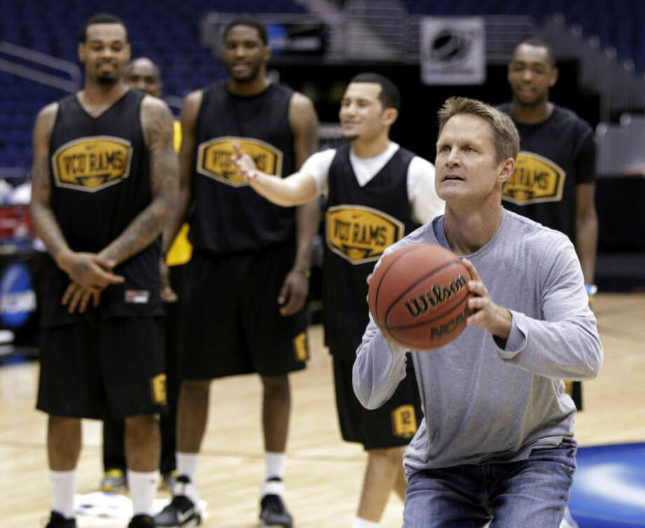 FILE - In this March 24, 2011, file photo, former NBA player Steve Kerr participates in a shooting contest with members of the VCU team during a practice for a Southwest regional semifinal in the NCAA men's college basketball tournament in San Antonio. The Golden State Warriors have won the bidding war with the New York Knicks for Kerr, hiring him away from the TNT broadcast table to be their coach. Kerr agreed to a five-year, $25 million deal Wednesday, May 14, 2014, said his agent, Mike Tannenbaum. (AP Photo/Tony Gutierrez, File)