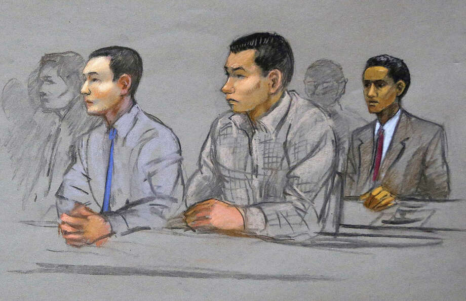 FILE - In this May 13, 2014 file courtroom sketch, defendants Azamat Tazhayakov, left, Dias Kadyrbayev, center, and Robel Phillipos, right, college friends of convicted Boston Marathon bomber Dzhokhar Tsarnaev, sit during a hearing in federal court in Boston. The three, all friends who attended the University of Massachusetts-Dartmouth with Tsarnaev, face sentencing during the first week of June 2015 for obstructing the investigation and lying. (Jane Flavell Collins via AP, File)