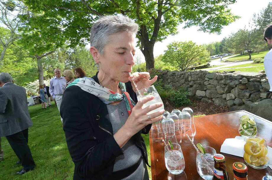 Rachel Bacaban enjoys one of the Spring Tonics at the Wilton Family Y Community Celebration and dinner at Millstone Farm in Wilton Conn, Mayy 22 2016