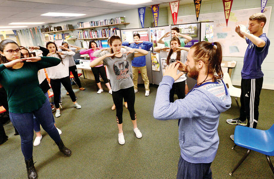 Norwalk High School students take part in a meditation workshop led by holistic health coach, Aaron Weston, to improve their social and emotional well-being Thursday May 19, 2016, at the school. The school plans on launching a new program this fall to help students dealing with high stress and behavioral issues.