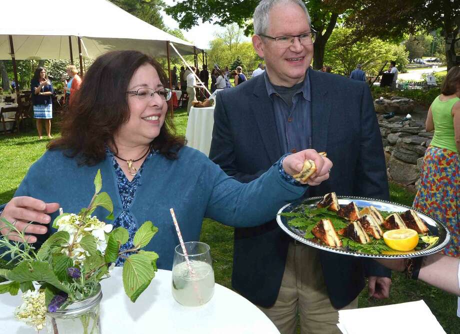 Mariann Covello and Ken Kasakoff enjoys the grilled mushroom cheese appetizers at the Wilton Family Y Community Celebration and dinner at Millstone Farm in Wilton Conn, Mayy 22 2016
