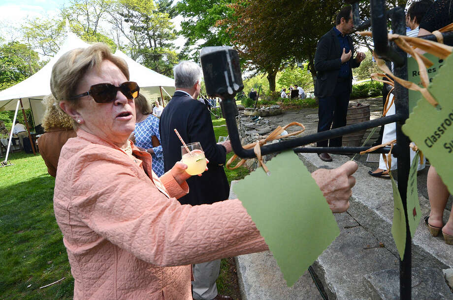 Judy Higby takes a donation card from one of the giving trees at the Wilton Family Y Community Celebration and dinner at Millstone Farm in Wilton Conn, Mayy 22 2016