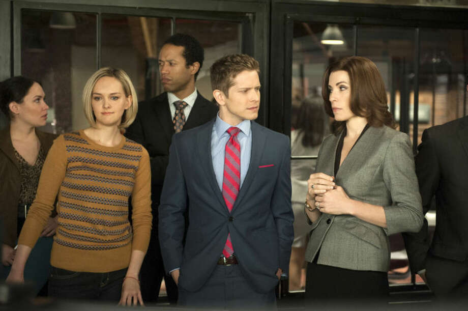 """(AP Photo/CBS, Jojo WhildenThis image released by CBS shows, front row from left, Jess Weixler, Matt Czuchry and Julianna Margulies in a scene from """"The Good Wife"""". Airing its season finale Sunday at 9 p.m. EDT, the show has replenished the stripped-bare courtroom genre with complex storylines that employ human relationships as much as legal brinksmanship."""