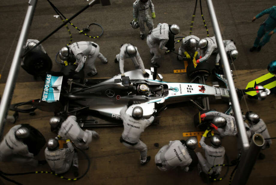 AP10ThingsToSee - Mercedes driver Lewis Hamilton, of Britain, gets a pit service during the Spain Formula One Grand Prix at the Barcelona Catalunya racetrack in Montmelo, near Barcelona, Spain, Sunday, May 11, 2014. (AP Photo/Emilio Morenatti)