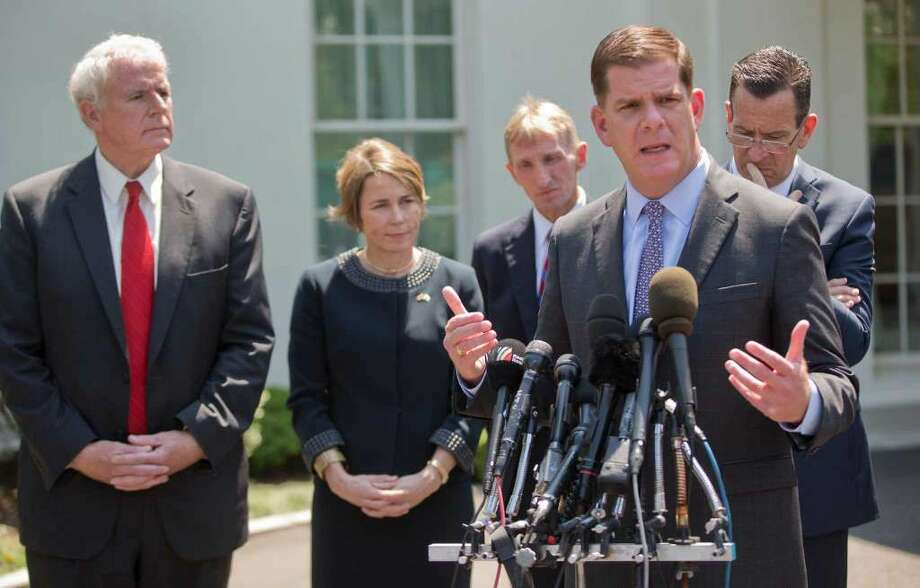 Boston Mayor Marty Walsh, right, speaks to members of the media outside the White House in Washington, Tuesday, May 24, 2016, after a meeting between State and local leaders committed to preventing and reducing gun violence. From left are, Milwaukee MayorTom Barrett, Massachusetts Attorney General Maura Tracy Healey, Boston Police Commissioner William B. Evans, and Walsh Connecticut Governor Dannel Malloy. (Photo: Pablo Martinez Monsivais / Associated Press)