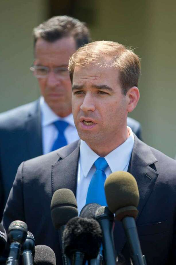 Hartford, Conn. Mayor Luke Aaron Bronin, accompanied by Connecticut Gov. Dannel Malloy, speaks to members of the media outside the White House in Washington, Tuesday, May 24, 2016, following a meeting between state and local leaders committed to preventing and reducing gun violence. (Photo: Pablo Martinez Monsivais / Associated Press)