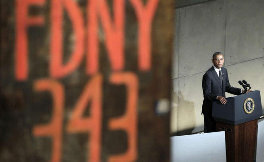 President Barack Obama speaks at the dedication ceremony for the National September 11 Memorial Museum on Thursday, May 15, 2014 in New York. (AP Photo/John Angelillo,Pool)