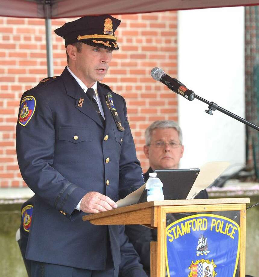 Hour Photo/Alex von Kleydorff Assistant Police Chief James Matheny speaks about how officers risk their lives during Stamford's Peace Office Memorial Day at Headquaters